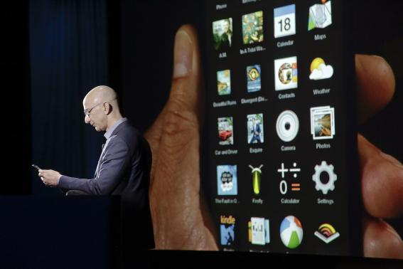 Amazon CEO Bezos shows off the 3D features of his company's new Fire smartphone in Seattle, Washington